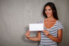 Charismatic woman holding letter while smiling Royalty Free Stock Images