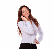 Charismatic woman talking on mobile phone Royalty Free Stock Images