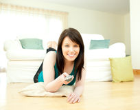 Charismatic woman watching television Royalty Free Stock Image