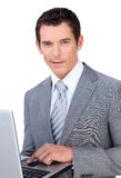 Charismatic young businessman using a laptop Stock Photos