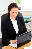 Charismatic young businesswoman using her laptop Royalty Free Stock Photos