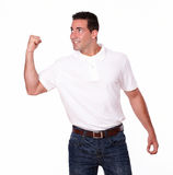 Charismatic young guy celebrating his victory Stock Photo