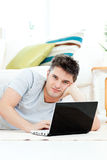 Charismatic young man using his laptop at home Royalty Free Stock Image
