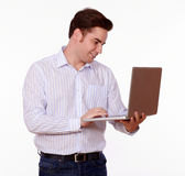 Charismatic young man working on his laptop Stock Photo