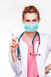 Charismatic young medic with syringe Stock Images