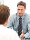 Charismatischer Manager während einer Sitzung Lizenzfreies Stockbild