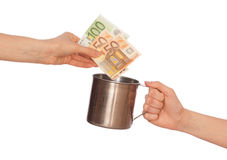 Charity. Woman giving donation euro money in the mug Royalty Free Stock Photography