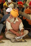 Charity. A men eating at a sikh temple in Delhi Stock Images
