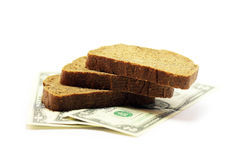 Charitable aid to the poor. Two dollars and bread to symbolize donations Royalty Free Stock Image
