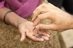 Charity. The man's hand gives alms in a female hand royalty free stock photos
