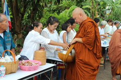 Charity activities in buddhism Stock Photos