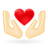 Charity and care - hands with heart Stock Image
