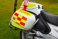 Charity collection tin on blood emergency delivery motorbike Royalty Free Stock Photo