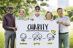 Charity Community Share Help Concept. Seniors group showing charity word plate Royalty Free Stock Images