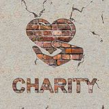 Charity Concept on the Brick Wall. Stock Photo