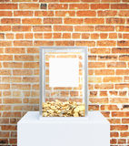 Charity concept. Glass box with blank label and golden coins on red brick background. Charity concept, Mock up, 3D Rendering Royalty Free Stock Photos