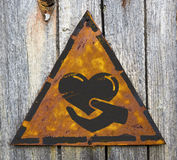 Charity Concept on Weathered Warning Sign. Stock Photo