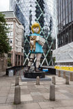 Charity by Damien Hirst. A Damien Hirst sculpture which highlights an outdated vision of disability has been installed in London as part of a new exhibition. The royalty free stock photography