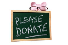 Charity donation box message, piggy bank wearing glasses, isolated on white Stock Photo