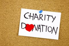Charity donation phrase handwritten on sticky note pinned to a cork notice heart symbol instead of O. Concept stock images