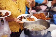 Charity food is the hope of the poor who have no money : concept of begging food : Donate food to people in society : Volunteers. Share Food to the Poor royalty free stock photo