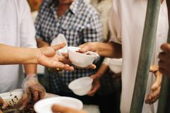 Charity food is the hope of the poor who have no money: concept of begging food : Volunteers Share Food to the Poor to Relieve. Hunger royalty free stock images