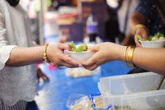 Charity food is the hope of the poor who have no money: concept of begging food : Volunteers Share Food to the Poor to Relieve. Hunger royalty free stock photo