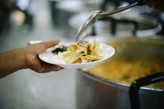 Charity food for the poor people to enjoy eating.  stock photography