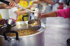 Charity food for the poor people to enjoy eating.  stock images