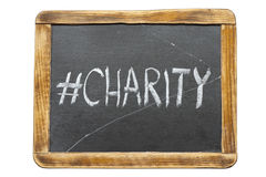 Charity hashtag fr. Charity hashtag handwritten on vintage school slate board isolated on white Stock Photos