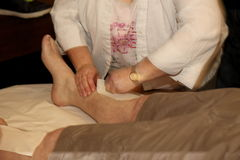 Charity leg waxing Royalty Free Stock Photo
