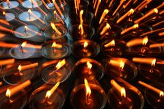 Charity. Praying candles in a monastery in Bhutan. Abstract, candlelight.