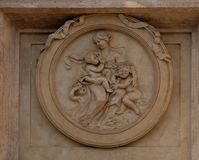 Charity Medallion on the Palazzo Montecitorio, seat of the Italian Chamber of Deputies in Rome Royalty Free Stock Photos