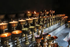 Charity. Praying candles in a monastery in Bhutan. stock photos