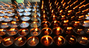 Charity. Praying candles in a monastery in Bhutan. royalty free stock photography