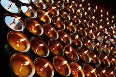 Charity. Praying candles in a temple. Stock Images