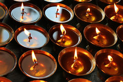 Charity. Praying candles in a temple. Royalty Free Stock Photography