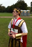 Charity run participant dressed in Roman clothes royalty free stock image