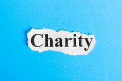 Charity text on paper. Word charity on a piece of paper. Concept Image Stock Image