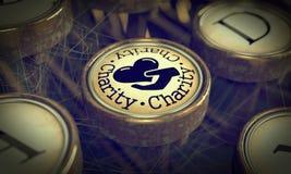 Charity Typewriter Key. Grunge Background. Royalty Free Stock Photo