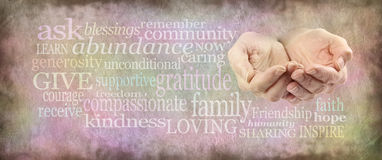 Charity Word Wall Banner. Wide stone effect background banner with various different sized healing words and a pair of female cupped hands on right size Stock Images