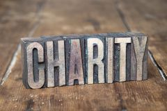 Charity word wood stock image
