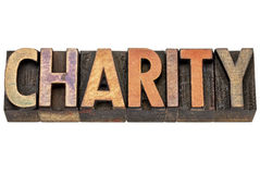 Charity word in wood type Stock Photos