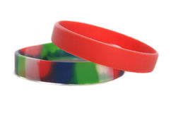 Charity wristbands cutout. Two Charity wristbands studio cutout Royalty Free Stock Images