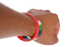 Charity wristbands on wrist cutout. Two Charity wristbands on wrist studio cutout Stock Images