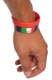 Charity wristbands on wrist cutout. Two Charity wristbands on wrist studio cutout Stock Photography