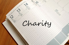 Charity write on notebook Stock Photography