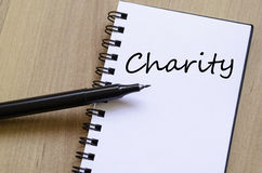 Charity write on notebook Royalty Free Stock Photography