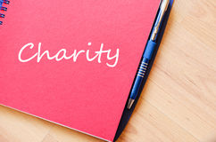 Charity write on notebook Royalty Free Stock Image