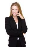 Charla de la empresaria en el teléfono Foto de archivo